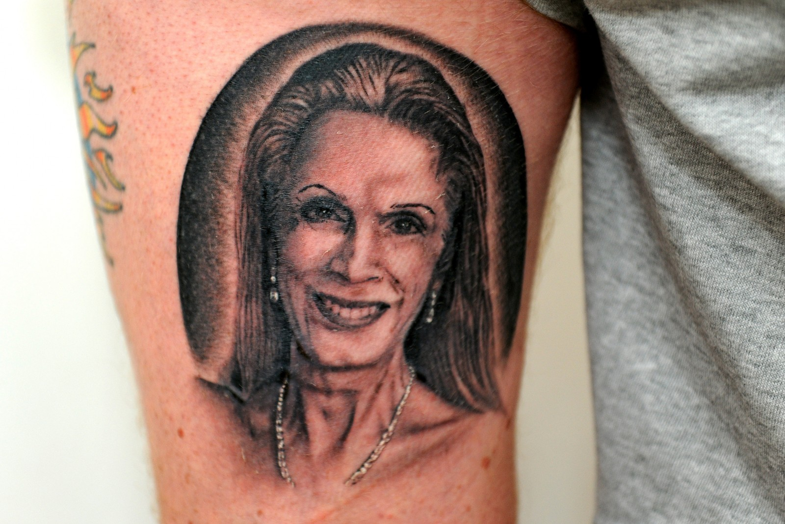 Richard shows off his tattoo of the controversial reality tv star