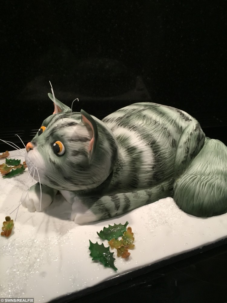 """The cake inspired by the SainsburyÃs Christmas advert à of MOG. See SWNS story SWMOG; Sarah Leftley, 45, spent two days building the show-stopping creation which is flawlessly sculpted into the shame of Judith KerrÃs beloved character. The single mum-of-three and amateur baker shared the picture online and received more than 40,000 likes and thousands of comments praising the design. Sarah, from Horley, Surrey, said: """"It's all gone a bit bonkers."""