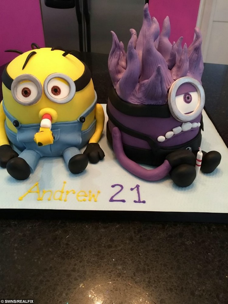 """A Minion and Evil Minion inspired cake creations made by Sarah Leftly. See SWNS story SWMOG; A sweet-toothed mum has stunned the internet with a cake inspired by the SainsburyÃs Christmas advert à of MOG. Sarah Leftley, 45, spent two days building the show-stopping creation which is flawlessly sculpted into the shame of Judith KerrÃs beloved character. The single mum-of-three and amateur baker shared the picture online and received more than 40,000 likes and thousands of comments praising the design. Sarah, from Horley, Surrey, said: """"It's all gone a bit bonkers."""
