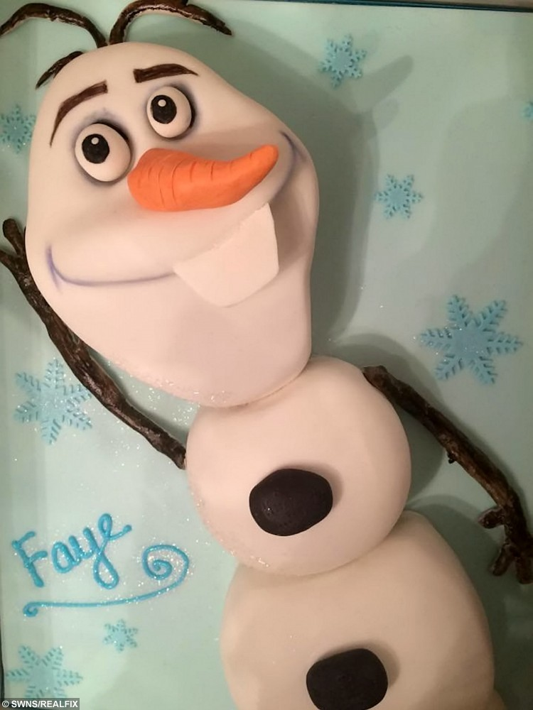 """An Olaf from Frozen inspired cake by Sarah Leftly. See SWNS story SWMOG; A sweet-toothed mum has stunned the internet with a cake inspired by the SainsburyÃs Christmas advert à of MOG. Sarah Leftley, 45, spent two days building the show-stopping creation which is flawlessly sculpted into the shame of Judith KerrÃs beloved character. The single mum-of-three and amateur baker shared the picture online and received more than 40,000 likes and thousands of comments praising the design. Sarah, from Horley, Surrey, said: """"It's all gone a bit bonkers."""