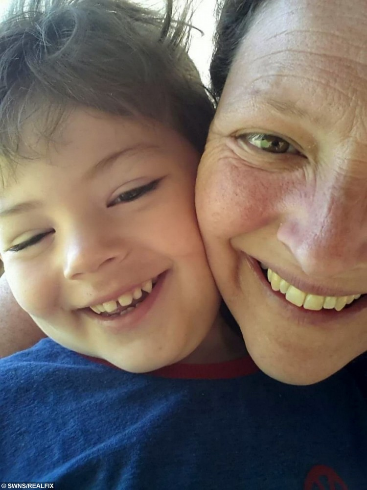"Kelly Morris in a selfie with her son Jacob in summer 2014. See SWNS story SWTRAGIC; A tragic mum who gave birth after doctors said she was infertile has been told she has terminal cancer - meaning she will have to leave behind her ""miracle"" son. Kelly Morris, 40, had one of her ovaries removed after being struck down by ovarian cancer in July 2010, and was told it was ""extremely unlikely"" she'd ever have children. But miraculously, support worker Kelly, from Longfield, Kent, fell pregnant with son Jacob three months later and since he was born in 2011, the pair have been inseparable. Tragically, she was diagnosed with a rare brain cancer in May this year."