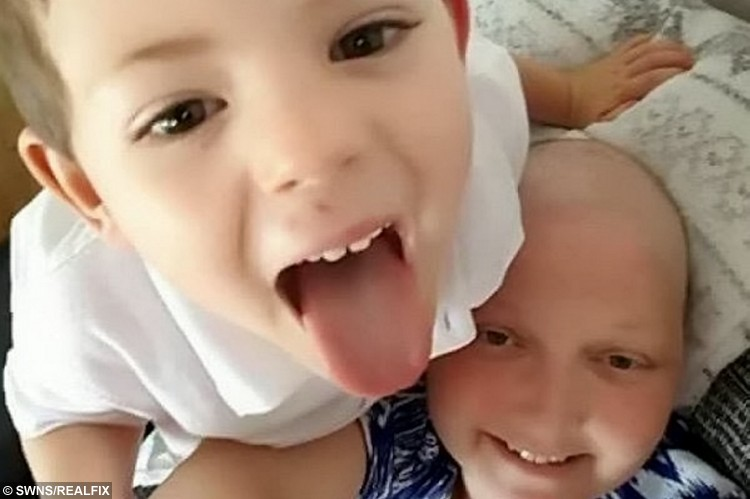 "Kelly Morris in September 2015 with her son Jacob. See SWNS story SWTRAGIC; A tragic mum who gave birth after doctors said she was infertile has been told she has terminal cancer - meaning she will have to leave behind her ""miracle"" son. Kelly Morris, 40, had one of her ovaries removed after being struck down by ovarian cancer in July 2010, and was told it was ""extremely unlikely"" she'd ever have children. But miraculously, support worker Kelly, from Longfield, Kent, fell pregnant with son Jacob three months later and since he was born in 2011, the pair have been inseparable. Tragically, she was diagnosed with a rare brain cancer in May this year."