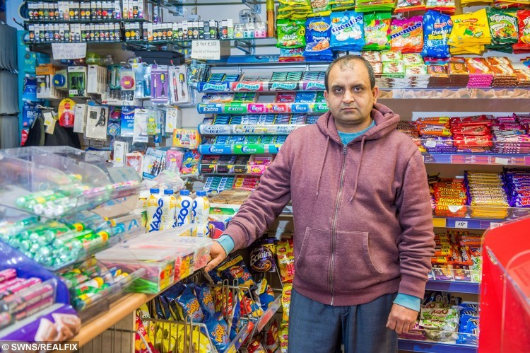 Newsagent Muhammad Ashfaq who was attacked in his shop but fought off a masked robber using a bottle of IRN BRU. See Centre Press story CPJUICE; A SHOPKEEPER and his assistant fought off a masked robber who tried to steal cash in the latest in a string of raids on his shop. Hamad Ashfaq was behind the counter at MM News Store on Boswall Parkway, Pilton, when the man burst in and demanded money. The suspect – who waswho was wearing a black balaclava – punched Mr Ashfaq in the head and chest while screaming at him to open the till. Despite being injured, Mr Ashfaq fought back while his assistant threw a bottle of juice at the man's head. He then pursued the robber when he fled the shop empty-handed, but lost sight of him as he entered Crewe Place shortly afterwards. Mr Ashfaq, who has run the store with his brother and cousin for seven years, said he suspected the robber had something sharp and heavy within his gloves during Monday night's incident.