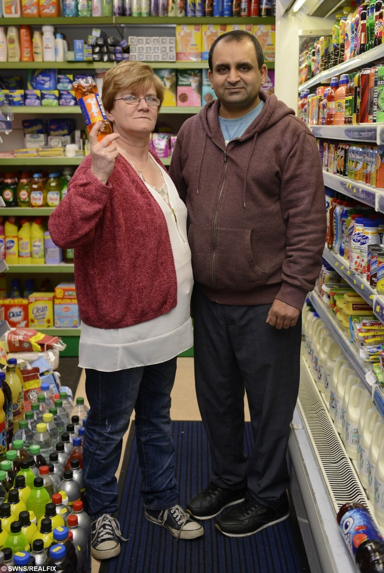 Shopkeeper Muhammad Ashfaq, (R) with his assistant Yvonne Burns, 56, at MM News Store in Boswall Parkway, Pilton, Edinburgh, where a robbery was foiled with an Irn Bru Bottle. See Centre Press story CPJUICE; A SHOPKEEPER and his assistant fought off a masked robber who tried to steal cash in the latest in a string of raids on his shop. Hamad Ashfaq was behind the counter at MM News Store on Boswall Parkway, Pilton, when the man burst in and demanded money. The suspect – who waswho was wearing a black balaclava – punched Mr Ashfaq in the head and chest while screaming at him to open the till. Despite being injured, Mr Ashfaq fought back while his assistant threw a bottle of juice at the man's head. He then pursued the robber when he fled the shop empty-handed, but lost sight of him as he entered Crewe Place shortly afterwards. Mr Ashfaq, who has run the store with his brother and cousin for seven years, said he suspected the robber had something sharp and heavy within his gloves during Monday night's incident.