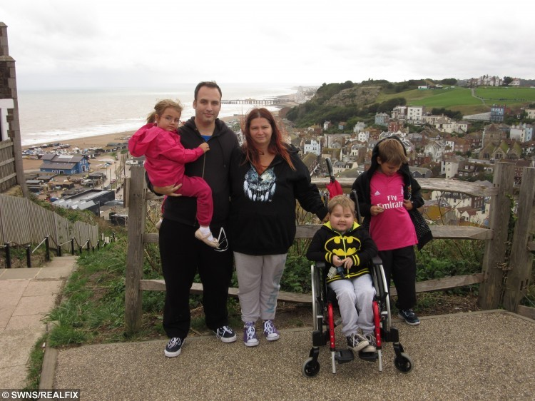 Jamie-Lee Dearing, 7, from Ditton, Kent. Pictured with mum Jodie, dad Lee, older sister Holly, 15, older brother Cameron, 11, and younger sister Lara, 5.   See Masons copy MNVOMIT: A desperate mother is appealing for help in a bid to save her son from an inoperable brain tumour - which makes him vomit up to 15 times A DAY. Seven-year-old Jamie-Lee Dearing has sadly suffered for years after a history of different illnesses. Last year he was diagnosed with an inoperable cancerous brain tumour which is located in the part of the brain that controls vomiting. The poor little boy has to take strong steroids to stem the sickness but even those have a detrimental effect on his health. Now his mother, Jodie, aims to raise £150,000 in a bid to send Jamie-Lee to America for radiation treatment to shrink the deadly tumour.