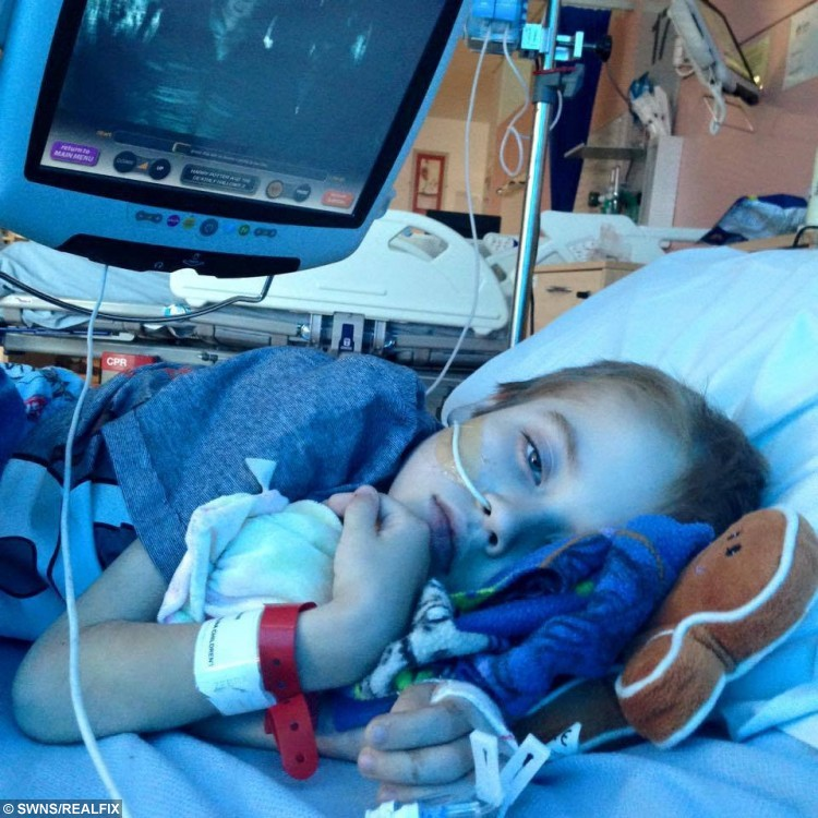 Jamie-Lee Dearing, 7, from Ditton, Kent, during his time in hospital.  See Masons copy MNVOMIT: A desperate mother is appealing for help in a bid to save her son from an inoperable brain tumour - which makes him vomit up to 15 times A DAY. Seven-year-old Jamie-Lee Dearing has sadly suffered for years after a history of different illnesses. Last year he was diagnosed with an inoperable cancerous brain tumour which is located in the part of the brain that controls vomiting. The poor little boy has to take strong steroids to stem the sickness but even those have a detrimental effect on his health. Now his mother, Jodie, aims to raise £150,000 in a bid to send Jamie-Lee to America for radiation treatment to shrink the deadly tumour.