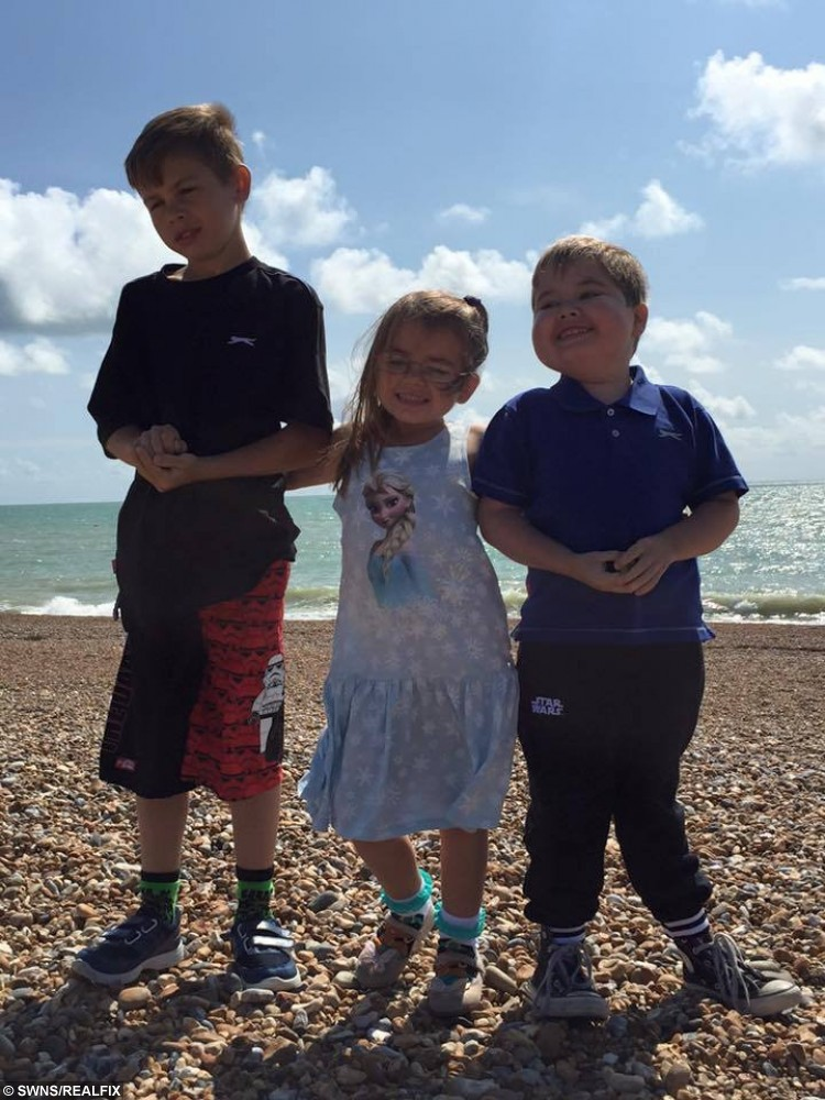 Jamie-Lee Dearing, 7, from Ditton, Kent, during his time in hospital. Pictured with older brother Cameron, 11, and younger sister Lara, 5.   See Masons copy MNVOMIT: A desperate mother is appealing for help in a bid to save her son from an inoperable brain tumour - which makes him vomit up to 15 times A DAY. Seven-year-old Jamie-Lee Dearing has sadly suffered for years after a history of different illnesses. Last year he was diagnosed with an inoperable cancerous brain tumour which is located in the part of the brain that controls vomiting. The poor little boy has to take strong steroids to stem the sickness but even those have a detrimental effect on his health. Now his mother, Jodie, aims to raise £150,000 in a bid to send Jamie-Lee to America for radiation treatment to shrink the deadly tumour.