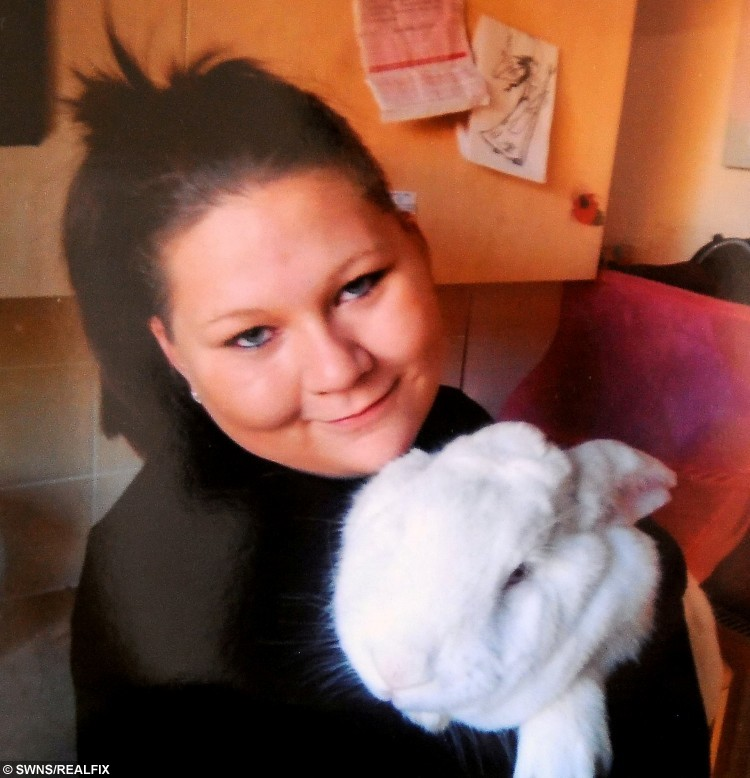 Shannon Carter, 23, with Milky, a giant continental rabbit who died after having its ears chopped off by thugs. A family has been left heartbroken after their beloved pet rabbit was slaughtered by callous thugs - who chopped off his EARS and left him to bleed to death.  See NTI story NTIRABBIT.  Devastated Shannon Carter, 23, and her partner Lee Aram, 37, were woken up by their dog Poppy barking at 2am on Saturday (2/1).  But as the couple let out their pooch they were horrified to find giant continental rabbit, Milky, lying dead in a pool of blood in the middle of the garden path.  Sick yobs had broke into the family's shed to cruelly butcher the 18-month-old pet, before hacking off and stealing his ears and dumping him next to a back door.