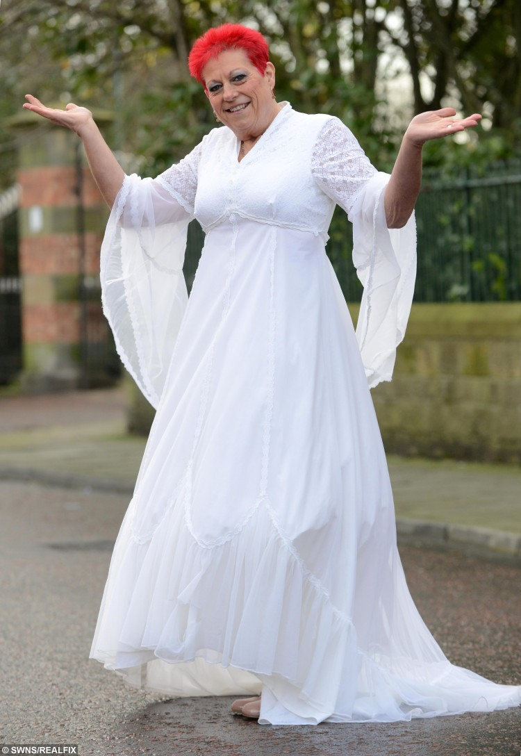 """Alison Berry from South Shields, Tyne and Wear, who has lost 10 stone with the help of Slimming World and is able to fit in her wegging dress from 38 years ago. See Ross Parry copy RPYBRIDE : A super slimmer is celebrating after losing HALF her body weight - meaning she's able to slip back into the wedding dress she wore 38 years ago. Alison Berry, 56, had ballooned to 22st 1.5lbs after years of yo-yo dieting, leaving her wearing a dress size 30 to 32. But after going on a 10-stone super slimming spree, she slimmed down to 12st 1lb as is now even able to squeeze into the wedding dress she wore in 1978 as a fresh-face 18-year-old. The mum-of-three, from Hebburn, Tyne & Wear, said: """"I found my dress in a box the other day and just thought I would try it on and I just couldn't believe it when it fit.  """"I was quite emotional about it. It was a week before my 19th birthday when I got married so to think I'm back to the size I was then is amazing."""