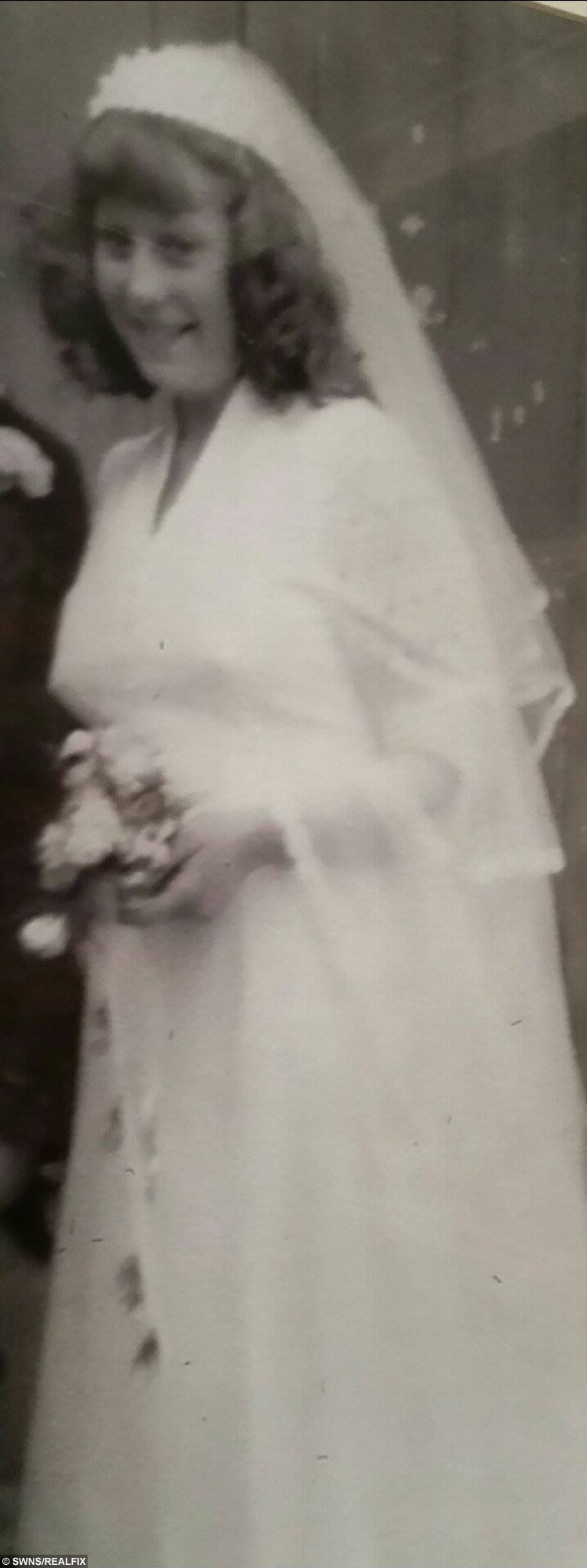 """Alison Berry from South Shields, Tyne and Wear, who has lost 10 stone with the help of Slimming World and is able to fit in her wegging dress from 38 years ago. Alison Berry on her wedding day, June 24, 1978. See Ross Parry copy RPYBRIDE : A super slimmer is celebrating after losing HALF her body weight - meaning she's able to slip back into the wedding dress she wore 38 years ago. Alison Berry, 56, had ballooned to 22st 1.5lbs after years of yo-yo dieting, leaving her wearing a dress size 30 to 32. But after going on a 10-stone super slimming spree, she slimmed down to 12st 1lb as is now even able to squeeze into the wedding dress she wore in 1978 as a fresh-face 18-year-old. The mum-of-three, from Hebburn, Tyne & Wear, said: """"I found my dress in a box the other day and just thought I would try it on and I just couldn't believe it when it fit.  """"I was quite emotional about it. It was a week before my 19th birthday when I got married so to think I'm back to the size I was then is amazing."""