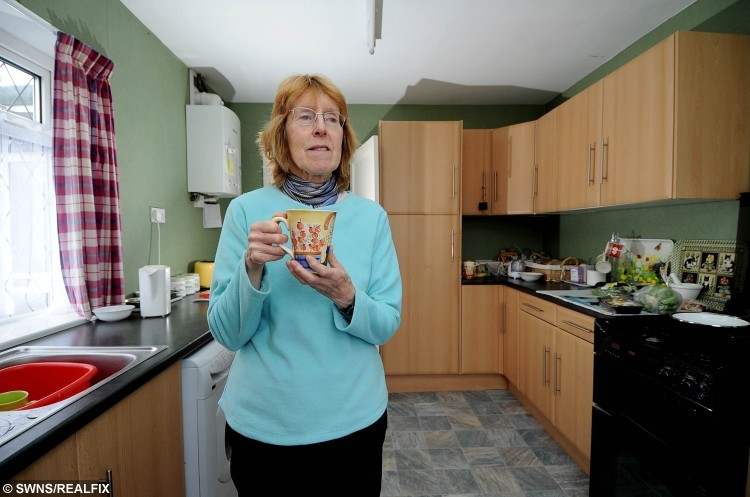 Britain's most frugal pensioner Ilona Richards from Scunthorpe, North Lincs. See Ross Parry story RPYFRUGAL; Meet Britain's most frugal pensioner Ilona Richards - who has made a washing-up liquid bottle last a whole YEAR. Ilona, 66, has gone the extra mile in penny-pinching, preferring to wear extra clothes and keep her heating off as well as making every meal for less than £1. She even asks guest to her home in Scunthorpe, North Lincs., to bring their own tea bags so she doesn't have to fork out for a cuppa. Her vacuum cleaner was found in a skip and instead of boiling a kettle to make tea she heats a mug of hot water in the microwave.