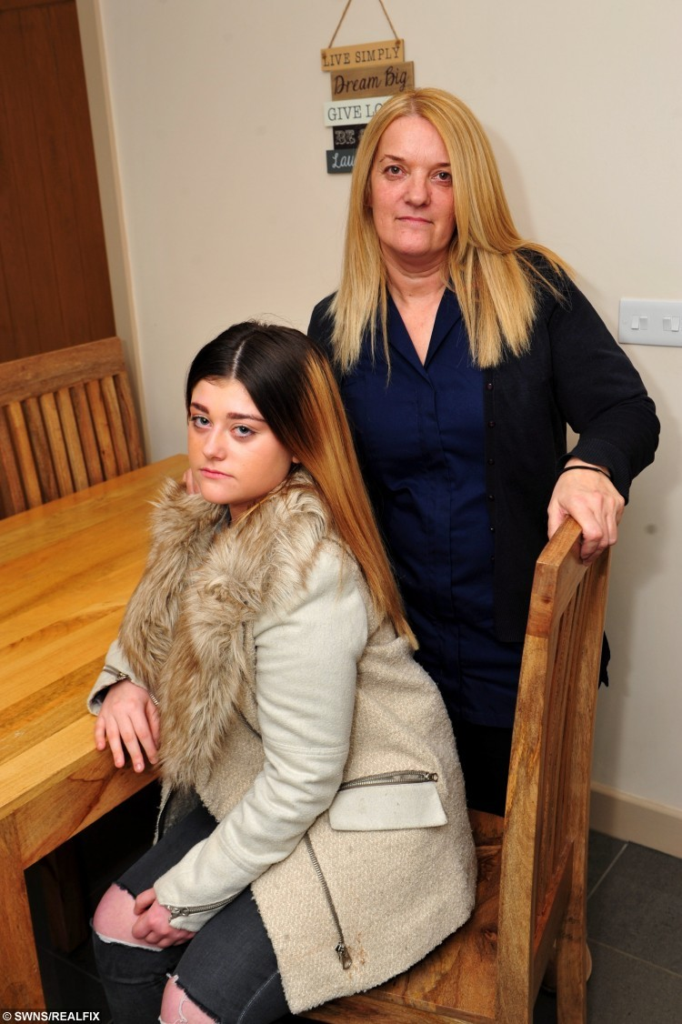 "13 year old Daisy Kelly from Grimsby, North Lincolnshire, who has been told she must do her school work in an 'inclusion unit' at school, due to her dip dyed hair style.Pictured at home with her mum, Diane Kelly. See Ross Parry copy RPYHAIR : A furious mum has threatened to pull her teenage daughter out of a top school after she was segregated from other pupils - because of a 'dip dye' hairstyle. Complex case nurse Diane Kelly has hit out at the school's decision to put her 13-year-old daughter Daisy into inclusion for her 'ombre' hairdo. Fuming Diane said that one teacher had even complimented the pupil on her new hairstyle at the start of term. However, the teen was put into ""inclusion"" last week and segregated from her schoolmates and classes. Tollbar School in Grimsby, North East Lincs.,  remains firm that students are not allowed two-tone hair, nor have ""extreme"" or ""vivid"" hair colours."