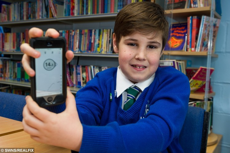 """Joe Everitt with the device which monitors his glucose levels. See SWNS story SWBLOOD; A diabetic schoolboy is one of the first in the UK to get a gadget which allows his mum to remotely check his blood via her phone - and TEXTS her when he needs a sugar hit. Joseph Everitt, nine, developed type 1 diabetes """"out of the blue"""" a year and a half ago and regularly has to monitor his blood to maintain his sugar levels. His parents had to prick his fingers up to TEN times a day, leaving them with sleepless nights and Joseph with numb fingers. They researched online and discovered a new gadget which constantly monitors his glucose levels through a sensor on his tummy."""