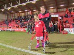Emotional moment Oskar takes his first steps in front of the football fans who enabled him to walk