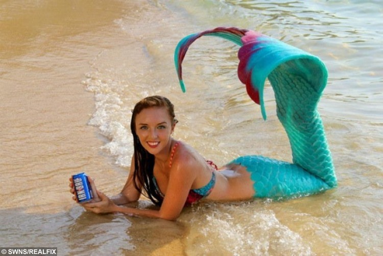Mermaid Melanie Long, 25, from Old Kilpatrick, who has made a living as a professional mermaid after being a scuba diving instructor. See Centre Press copy CPMERMAID: A girl who grew up idolising Ariel the Disney sea princess has achieved her dream - and now makes her living as a real life mermaid. Flame-haired Melanie Long, 25, grew up surrounded by murals of Ariel in her bedroom and told anyone who would ask that she wanted to be The Little Mermaid. But unlike most childhood dreams and ambitions, hers has come resoundingly true after she moved to Phuket, Thailand, five years ago to travel and work as a diver. Initially, Melanie, from Clydebank, West Dunbartonshire, worked as a scuba diving instructor.