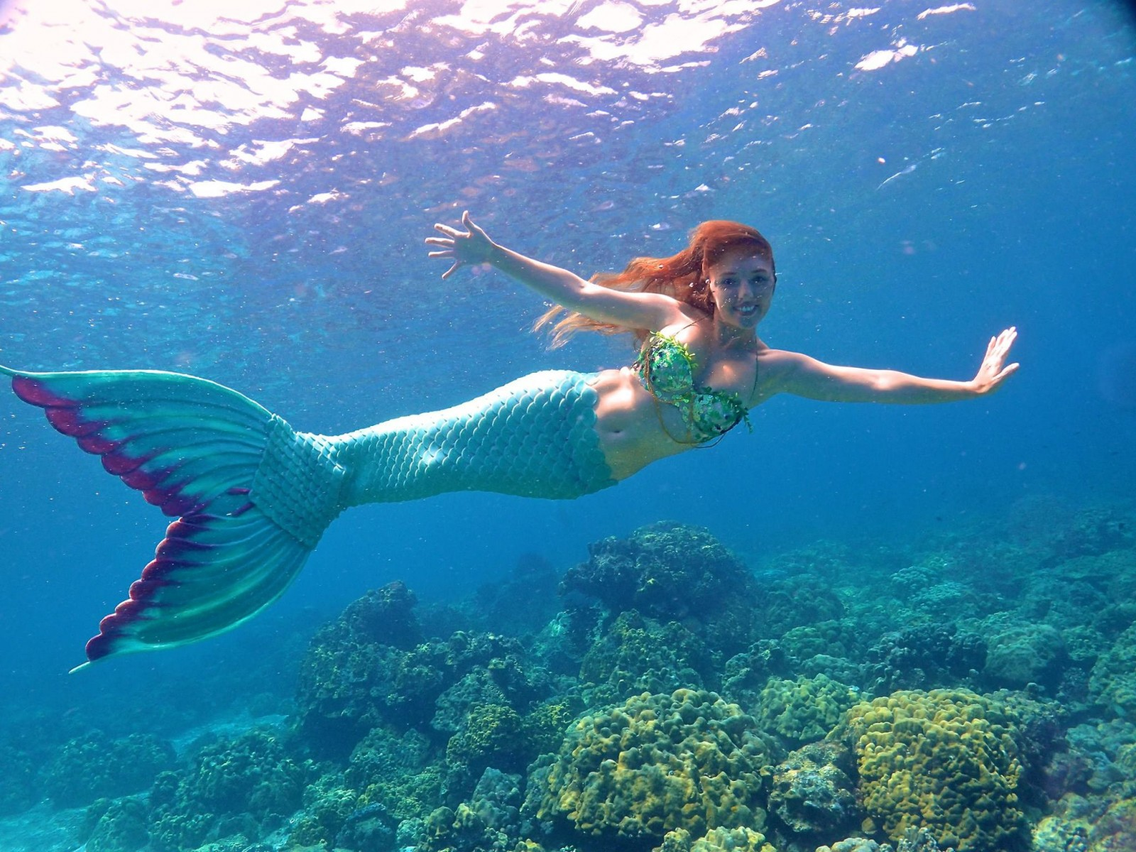 Woman who idolised Disney's Ariel now makes her living as a real life mermaid