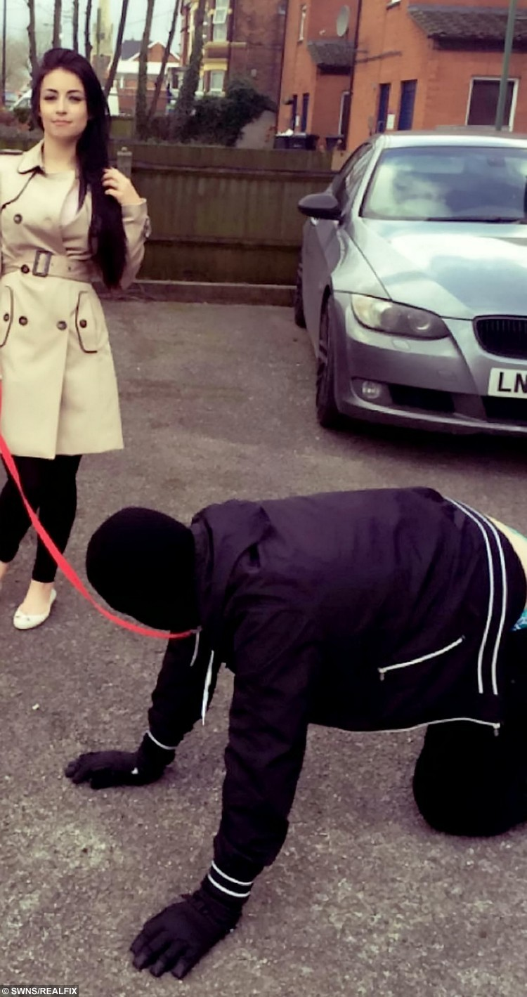 """Financial Dominatrix Paige Baron, 21, from Erdington, Birmingham.  A woman has admitted she is behind a bizarre viral video of a man being taken for 'walkies' like a dog - and revealed she was paid £1,000 for the privilege.  See NTI story NTIWALKIES.  The bizarre scene, which shows a woman walking a man on a leash, was filmed on Monday and has been viewed over 720,000 times already.  The man can be seen crawling on all fours, wearing gloves and a balaclava to mask his identity, and was filmed on Washwood Heath Road in Birmingham.  Paige Baron, 21, a financial dominatrix, says she was contacted on Twitter by a man who had a 'puppy fetish' and was desperate for someone to treat him like a dog.  Paige's partner can be heard in the video saying: 'He's here of his own free will. There's no law being broken. It's his choice. It's not forced upon him."""""""