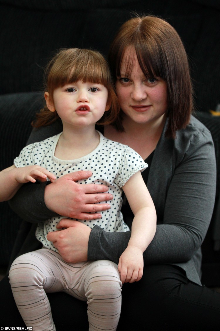 Clare Skill and daughter Sophie Skill, 2,  whose life was saved at Sheffield Children's Hospital last year after she swallowed a battery. See Ross Parry Copy RPYACID: A toddler is lucky to be alive after acid from a battery she swallowed burned through her lung. The injury was so severe that little Sophie Skill spent six days on life support following an emergency operation, and further months recovering in hospital, after swallowing a lithium battery the size of a 10p. Two-year-old Sophie was playing in her front room at home when mum Clare noticed she had become agitated and started to cry. She was crying excessively like I had never heard before, and she was holding the back of her neck, Clare said.