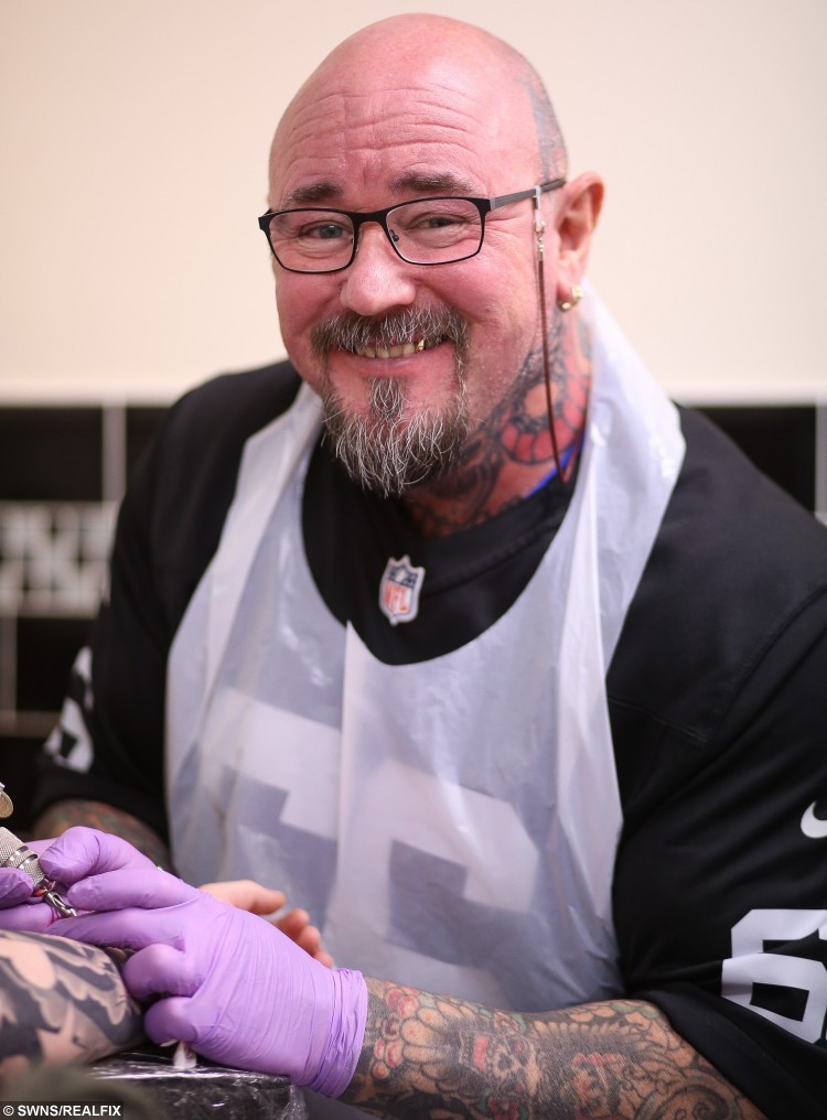 Paul Green at his tattoo shop.