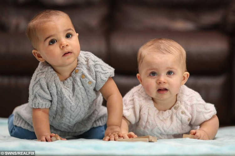 "Twins Amaya (right) with her mum's light skin, and Myla (left) with her dad's mixed race skin tone.  See SWNS story SWTWINS: A young mum who gave birth to twin girls of different colouring still can't believe she ""has one of each."" Hannah Yarker 20, and her partner Kyle Armstrong, 24, have one white twin and one black twin. Despite one-in-a-million chances Amaya has inherited her mother's fare skin while dark-skinned Myla takes after mixed-race Kyle. The couple from Sale, Greater Manchester, met in their local pub and three months later found out they were expecting."