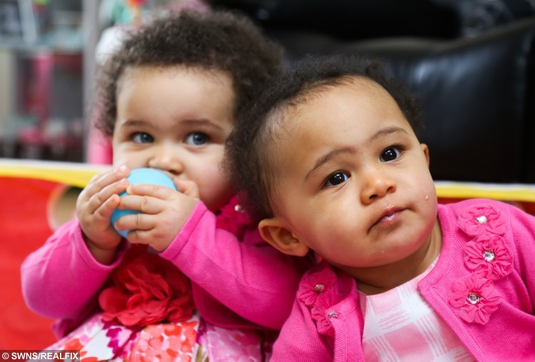"Identical sisters Amelia (right) and Jasmine - who have different skin an eye colour. See SWNS story SWTWINS; A mum has told how her one-year-old daughters get mistaken for step-sisters – despite the fact they're identical twins. During her pregnancy, Libby Appleby, 37, and her partner Tafadzwa Madzimbamuto, 40, were warned their twins would look so alike they would need to 'mark them with ink' to tell them apart. So they were shocked when their twins arrived in February 2015 - with contrasting skin tones. While elder twin Amelia has dark skin, black hair and brown eyes, her sister Jasmine has fair skin, blue eyes and mousey curls. Full-time mum Libby says: ""We were flabbergasted, even the doctors couldn't believe it. ""They look like they're different races."