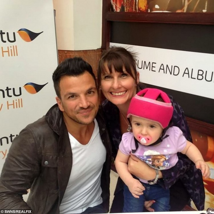 COLLECT - Georgie Gibbs and family meet Peter Andre.  There was not a dry eye in the room as Georgie Gibbs from Worcester, took her first steps since her life-changing operation.  See NTI story NTIWALK.  Determined Georgie managed to make her way along the parallel bars just a week after undergoing a selective dorsal rhizotomy to help her walk unaided.  Three-year-old Georgie, who has spastic diplegic rhizotomy, has hit all the expected milestones since the gruelling five-hour operation and doctors are pleased with the reduction of spasticity in her body.  She has been bed-bound then wheelchair-bound since the operation and usually walks with a frame.