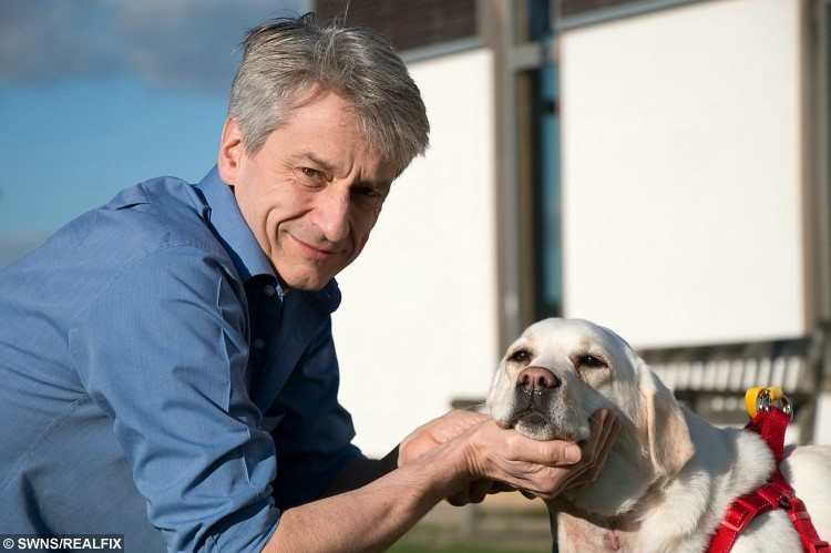 Professor Dan Brockman and Mabel outside the RVC's Queen Mother Hospital for Animals after surgery.