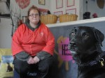 A woman who faints up to 25 times EVERYDAY has had her life turned around by her black Labrador – who warns her BEFORE she collapses.