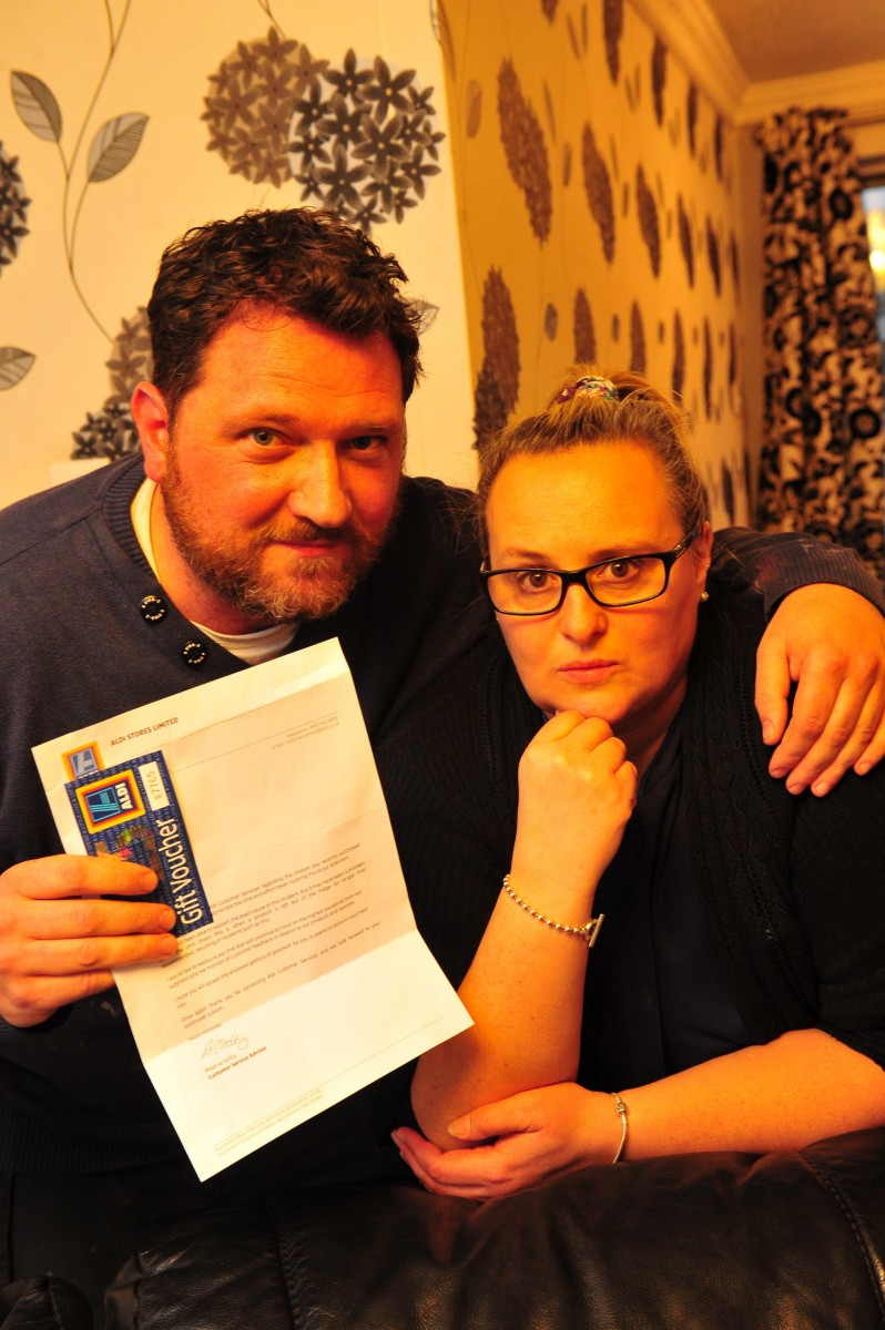 """Louise Snell from Hessle, East Yorkshire, who has told of the horrifying moment she carved up a full roast chicken for her family's dinner - only to find LUMINOUS GREEN bits inside. Pictured with her husband Chris. See Ross Parry copy RPYGREEN : Louise Snell, 46, described her cooked chicken as """"fluorescent green"""" and smelling """"like chemicals"""" after purchasing the poultry product from an Aldi store ready for her Sunday dinner. Mum-of-one Louise said the cooked food looked perfectly appetising from the outside - but the discoloured inside even turned herself green and made her vomit. Aldi have since apologised and pointed blame at the store's 'chilling process'. Louise, of Hull, East Yorks., said: """"My husband got home before me and he'd already started tea, so when I got in from work he asked me to carve the chicken."""
