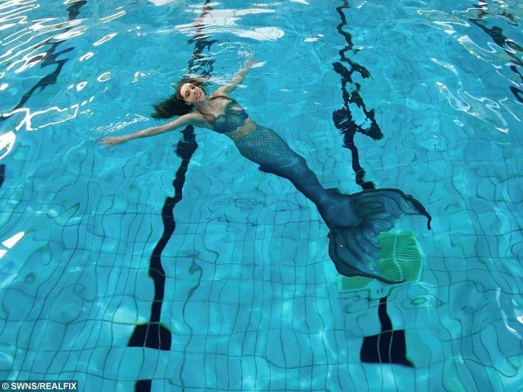 Michelle Roberts, 31, a professional mermaid from Blackpool, Lancs who even went to mermaid school to fulfill her dreams. See Ross Parry copy RPYSPLASH : A tuna-ful performer has told buoys and gills that they should follow their dreams - as she fulfilled hers to become a real-life MERMAID. Michelle Roberts, 31, who can hold her breath for a staggering two-and-a-half minutes, fell in love with the beautiful underwater creatures when she was just a little girl. Now she has fin-ally scaled the watery ladder to achieve her childhood ambition. Michelle, who goes by the brilliant mermaid name Merchelle, got her first tail from Santa when she was nine-years-old.