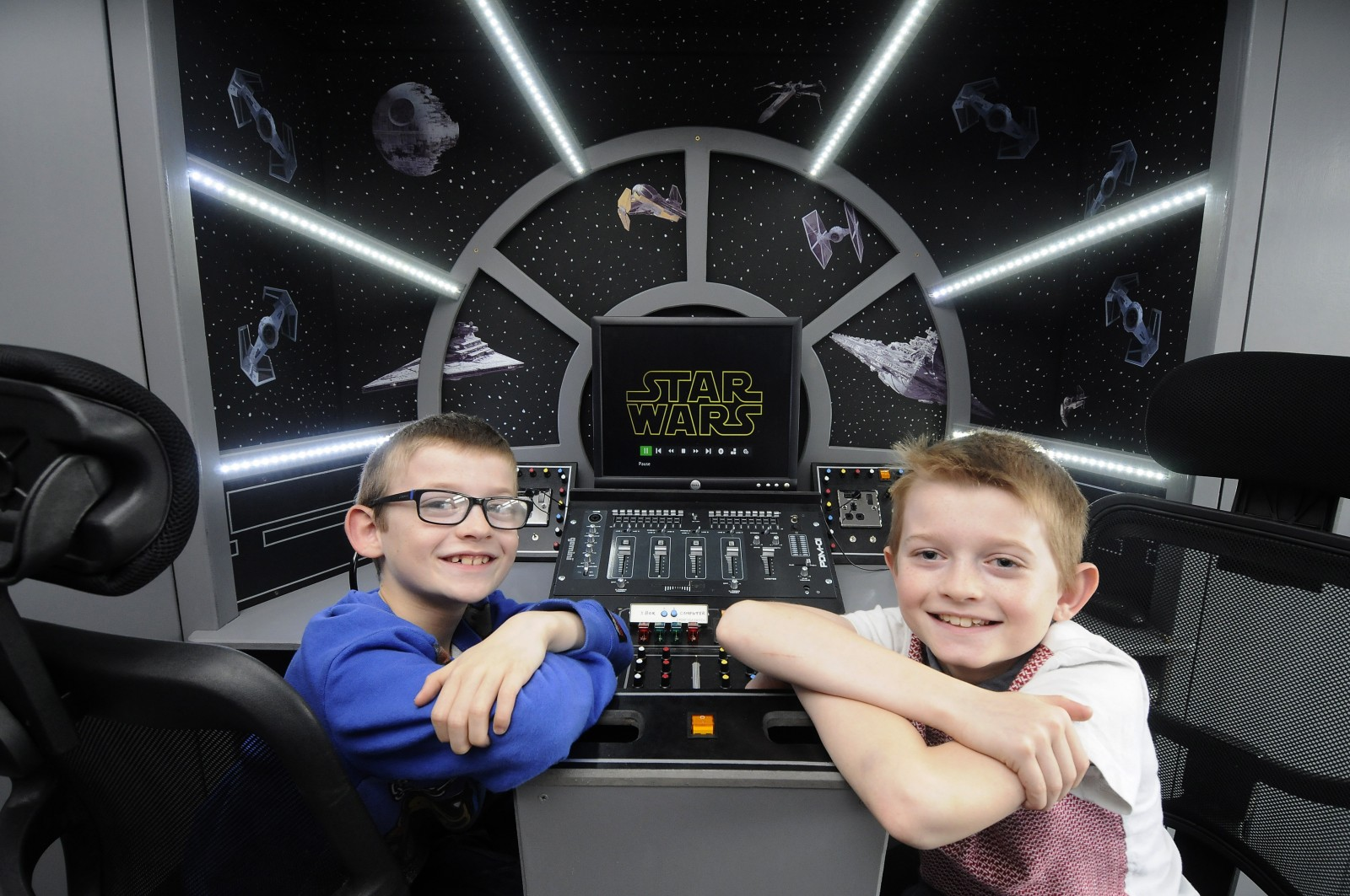 Dad Dave Bonney had built a Millenium Falcon entertainment centre in the bedroom of his two sons George, 8 and Dylan, 9. See Ross Parry Copy RPYSTAR : A devoted dad gave his kids a present that was out of this world - by transforming their room into a life-size replica of a Star Wars SPACESHIP. David Bonney, 47, surprised his Star Wars superfan kids, Dylan, nine, and George, eight, with a new bedroom based on the iconic Millennium Falcon from the hit movie franchise. The father-of-five hid his efforts for a month from his two sons who had no idea their sci-fi fantasies were about to come to life.
