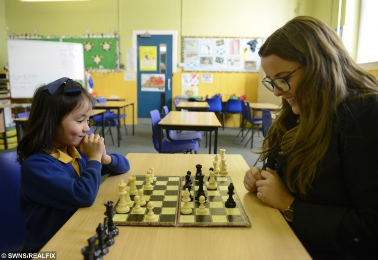 Child chess prodigy six-year-old Carolina Espinosa. See SWNS story SWCHESS: A six-year-old schoolgirl is causing a sensation in the normally staid world of Scottish chess – by beating off much older competition to land two major titles in just a month. Little Carolina Espinosa Cancino, who has been playing chess since the age of two, likes nothing more than singing along to her favourite musical, Annie, or humming the Let It Go soundtrack to Disney film Frozen. But when the chess board comes out she switches into junior master mode, leaving opponents more than three times her age trailing in her wake. Carolina, a pupil at Sacred Heart Primary school in Girvan, last month won the 2016 Scottish Junior Chess Tournament.
