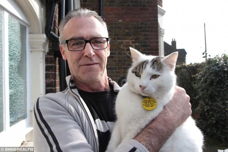Sean Ryan, 52, with his cat Eduardo.