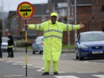 Scotland's happiest lollipop man is heart-broken after council chiefs ban him from high-fiving