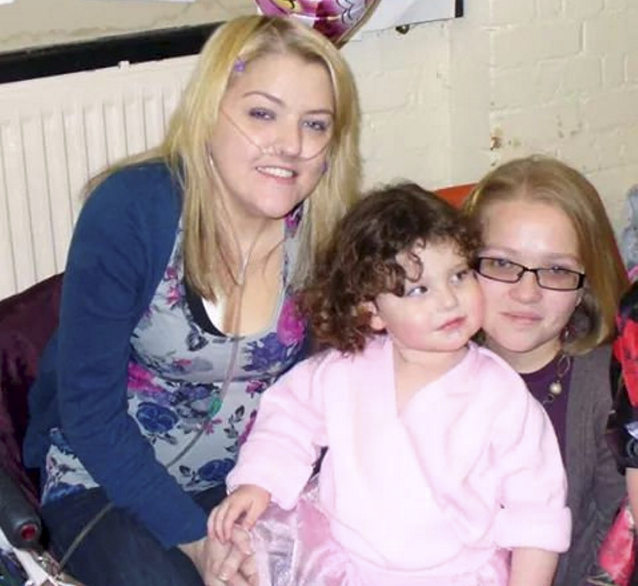 "Collect of Hayley Wall (L) with her sister Gemma(R) and her niece Maddie. A pioneering surgical technique has been used to give Hayley Wall from Plymouth, Devon, a new set of lungs  See SWNS story SWLUNGS; A petite cystic fibrosis sufferer has received a life-saving double lung transplant - after surgeons used a pioneering technique to TRIM the donor organs down to size. Former nursery worker Hayley Wall, 27, is just 4ft 8in and only six-and-a-half stone, making it difficult for doctors to find donor lungs small enough to fit her little body. But they were forced to rethink when her health deteriorated and used much-larger donor organs and kept them 'working' on a machine as they trimmed them down to fit. Upbeat Hayley, from Plymouth, Devon, is now recovering from the operation and is delighted to be taking her first deep breaths in decades. Inspirational Hayley said: ""I was told I could be waiting for more than 18 months and that my small size would make it difficult to find a matching pair."
