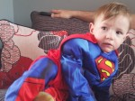 A premature baby has defied medics to breathe unaided – after his parents named him after SUPERMAN.