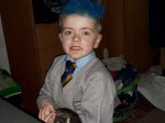 A five-year-old boy has been sent home by teachers for turning up for lessons with blue hair