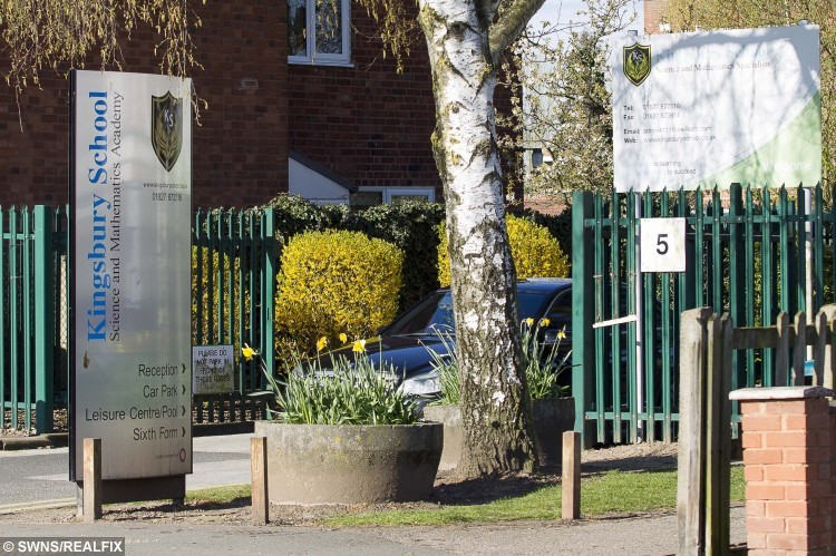 GV of Kingsbury School, Warwickshire. April 28, 2016. April 28, 2016. A 14-year-old girl had her finger amputated after it was almost ripped off when a playground prank went horribly wrong. See NTI story NTIPRANK. Lola Bennett was rushed to hospital after her hand slipped on a spiked fence as she tried to retrieve her school bag which had been hung there as a joke. She used a tree stump to reach the strap of her bag but her friendship ring got snagged on the fence and tore her finger apart as pals tried to yank off her shoe. Her horrified friends raised the alarm and ambulance crews dashed to the memorial garden in Kingsbury School, Tamworth, Staffs., last Friday (22/4). She was rushed to Birmingham Children's Hospital but surgeons were unable to save her middle finger on her left hand which was broken and had severe nerve damage. Brave Lola underwent a three-hour operation to have the digit amputated just below her knuckle. Despite her horror injury, Lola was back in lessons on Monday (25/4) and says she doesn't blame her friends for the accident.