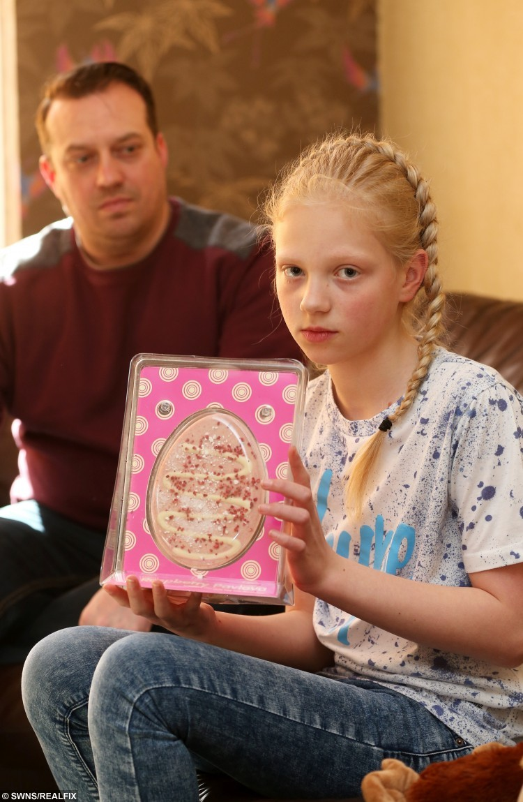 Lucy Hunt, 10 holds an Easter Egg purchased from the Range, in which she found a worm. Pictured with father Craig Hunt, 39.