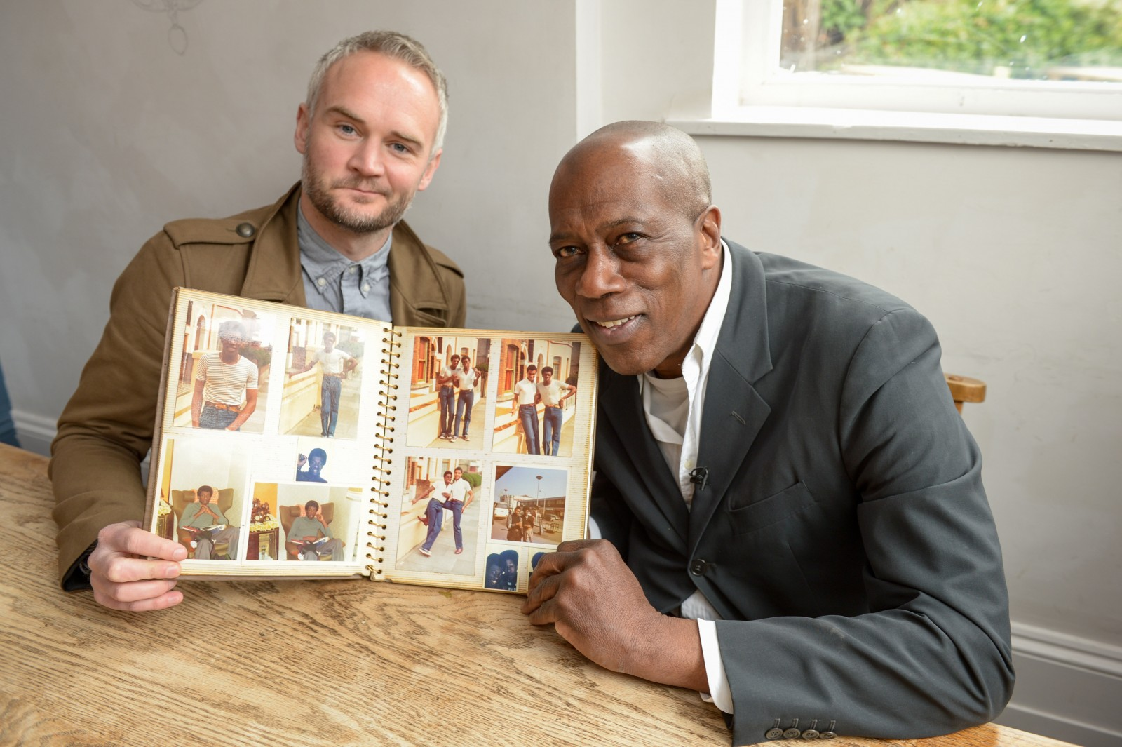 Man finds neighbour's lost photo album stuffed down the back of chair he bought online