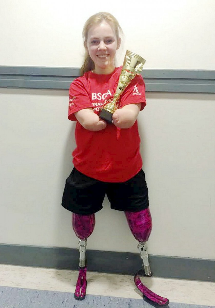 Izzy with her award after performing a  winning routine at a Schools National Championships