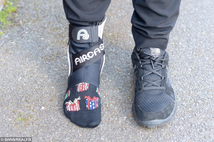 Sophie Bailey wearing her foot brace and black trainer.
