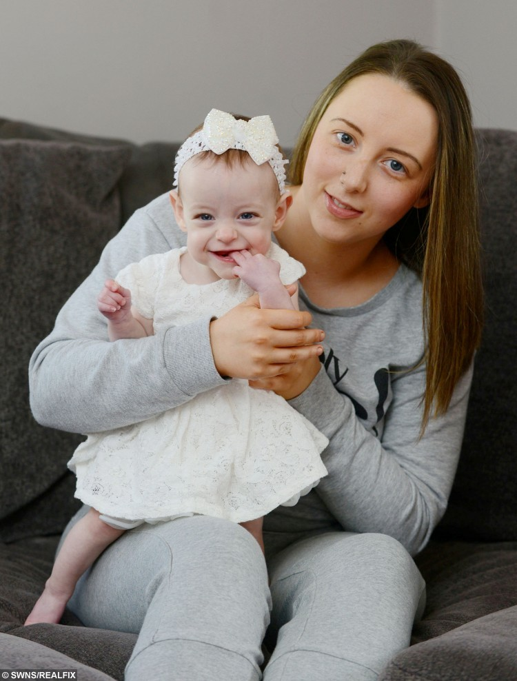 Skyla Robertson, with mum Nicole McGowan, at home in Johnstone, Renfrewshire, after celebrating her 1st birthday- against the odds after being born three months early weighing just 1lb 3oz. APRIL 05 2016 See Centre Press story CPMIRACLE; A tiny baby born weighing the same as half a bag of sugar has defied the odds to reach her first birthday. Teeny tot Skyla Robertson was born 14 weeks early still inside her amniotic sac – which protects a baby as it develops in the womb. She was so small – weighing just 1lb 3oz – that doctors told her parents Nicole McGowan and Anthony Robertson there was very little chance she would survive. But a year later miracle baby Skyla is doing well, despite still having a hole in her heart and weighing half the normal weight of a youngster her age.