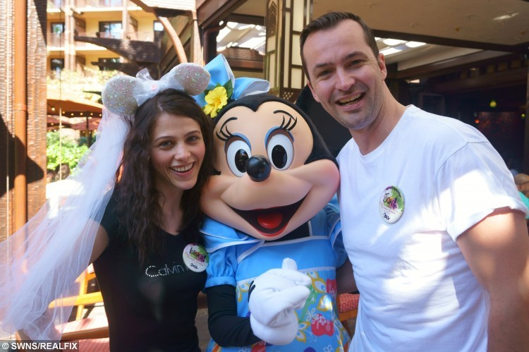 Collect photo - A Real-life Tinderella, Laura and Jonathan Colebrook during their Disney themed wedding day at Disney Resort, Aulani, Hawaii. January 2016. January 2016 A real-life Tinderella has told how she landed herself a fairytale wedding after swiping right for her Prince Charming - and she even lost her SHOE on the big day. See swns story SWTINDER. Once upon a time, in 2014, 27-year-old Laura Colebrook, a Disney-obsessed lawyer, found herself single and ready to mingle - so turned to Tinder.  She had only been on the dating app for a few weeks when she came across a potential suitor, dark-haired Jonathan Tapping, a 32-year-old IT consultant. After a mutual right swipe to indicate their attraction for one another, they struck up a conversation and immediately fell under one another's spell. On their first date, the pair decided to go to Disney World Florida together - Laura's 17th trip - and within weeks, Jon had hatched a plan to make the Disney fanatic his bride. He popped the question six months later during the Disney trip with a diamond platinum ring inside a Winnie the Pooh trinket box - and Laura said yes. In true fairytale fashion, the loved-up couple got married in a land far far away in a Cinderella-themed Disney wedding, on Waimanalo Beach in Oahu, Hawaii, in January.  To top it all off, Laura somehow lost her shoes as she rushed away from the ceremony - just like in the original Cinderella story.