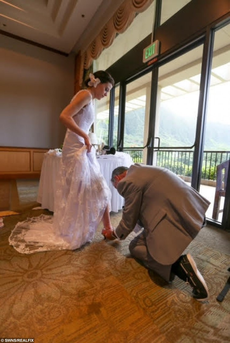 Collect photo - A Real-life Tinderella finds her shoe during their Disney themed wedding day at Disney Resort, Aulani, Hawaii. January 2016. January 2016 A real-life Tinderella has told how she landed herself a fairytale wedding after swiping right for her Prince Charming - and she even lost her SHOE on the big day. See swns story SWTINDER. Once upon a time, in 2014, 27-year-old Laura Colebrook, a Disney-obsessed lawyer, found herself single and ready to mingle - so turned to Tinder.  She had only been on the dating app for a few weeks when she came across a potential suitor, dark-haired Jonathan Tapping, a 32-year-old IT consultant. After a mutual right swipe to indicate their attraction for one another, they struck up a conversation and immediately fell under one another's spell. On their first date, the pair decided to go to Disney World Florida together - Laura's 17th trip - and within weeks, Jon had hatched a plan to make the Disney fanatic his bride. He popped the question six months later during the Disney trip with a diamond platinum ring inside a Winnie the Pooh trinket box - and Laura said yes. In true fairytale fashion, the loved-up couple got married in a land far far away in a Cinderella-themed Disney wedding, on Waimanalo Beach in Oahu, Hawaii, in January.  To top it all off, Laura somehow lost her shoes as she rushed away from the ceremony - just like in the original Cinderella story.