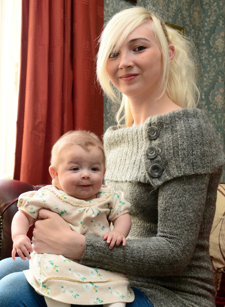 Paige Franks with daughter Mila Stevenson.  A young mum has slammed doctors after she was forced to Google her daughter's symptoms in order to correctly diagnose a tumour on her neck - the size of a GOLF BALL.  See NTI story NTITUMOUR.  Paige Franks, 20, was left horrified after noticing the unsightly 9cm lump on the back of little Mila Stevenson's neck after she gave birth five months ago.  Doctors at the Royal Stoke University Hospital diagnosed the youngster with a haemangioma following an MRI scan and provided the drug Propranolol to try and reduce the growth.  But Paige was not happy with the medication - which she says made her daughter freezing cold and struggling to breathe - and called for blood tests to be carried out.  After becoming frustrated at the lack of action, she decided to research the condition on the internet and eventually persuaded medics at London's Great Ormond Street Hospital to look at her case.  Yesterday (Tue) Paige blasted Royal Stoke Hospital - who even suggested chemotherapy for the baby - after tests revealed the growth will reduce naturally over time and required NO treatment.
