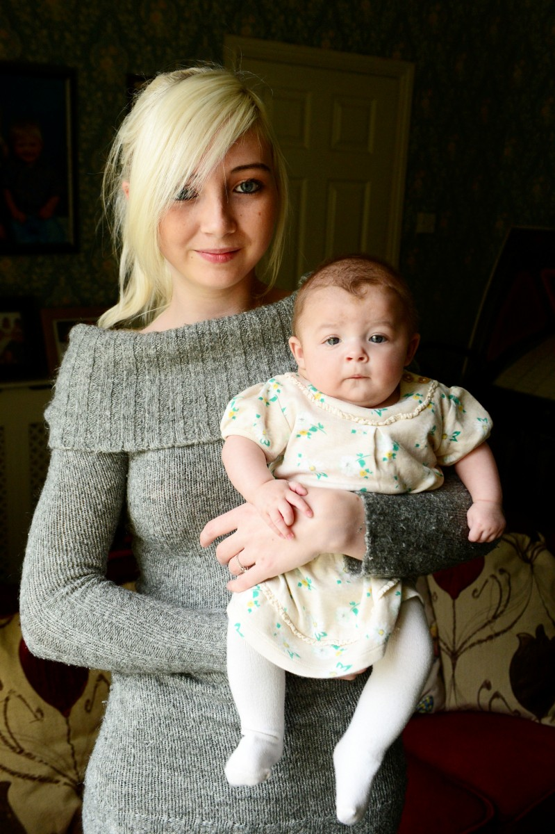 Paige Franks with daughter Mila Stevenson who is recovering after a tumour the size of a golf ball was discovered on her neck