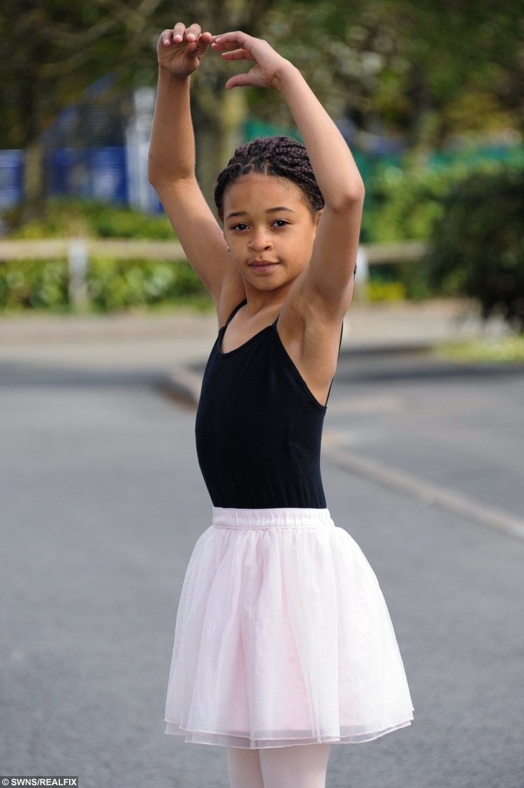 """Eve Elliott. A top ballet school has become embroiled in a racism row after a nine-year-old girl was banned from performing - for having braided HAIR. See NTI story NTIHAIR. Eve Elliott was left in tears after teachers told her she couldn't take part in a performance because her hairstyle made her """"look different to the other girls."""" Mum Lara Evans, 29, said her daughter had been left believing that """"brown girls can't do ballet"""" and the distraught youngster has vowed never to dance again. She claims Eve feels singled out for being mixed race after a string of bullying incidents over her skin colour at the prestigious Hereford Ballet School. The academy's principal Helen Dubovie Brown first told Lara the strict dress code stated all girls needed to have their hair smoothed back into a bun on April 5. But when Lara pointed out her braids could still be put into a bun she claims Mrs Dubovie Brown said it still made Eve """"look different""""."""