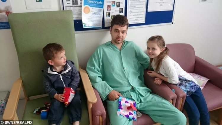 Ben Smith is treated in hospital after he was shot in the head - by his friend. He is pictured with his son Harley and daughter Alisha. See SWNS story SWBULLET; A dad-of-two who miraculously survived being shot in the head has lived the past year with a bullet lodged in his BRAIN. These incredible x-rays show the ammo jammed in the middle of Ben Smith's skull after he was accidentally shot at point blank range by his friend. Engineer Ben, 28, was shooting rabbits in May 2015 when the pal pointed the air rifle at him believing it was empty - and pulled the trigger. Incredibly, expectant father Ben lived to tell the tale but still has the 2.2 lead bullet in his brain as medics said removing it would be too risky.