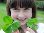 Nine-year-old girl strikes twice as lucky finding TWO five-leaf clovers